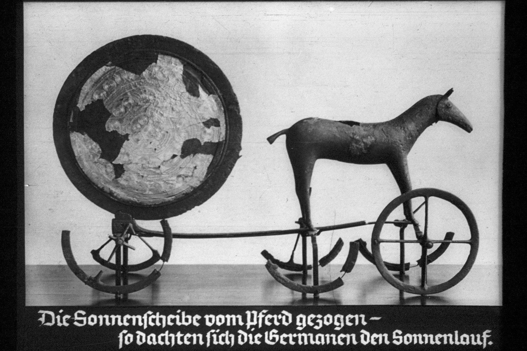 """24th Nazi propaganda slide for a Hitler Youth educational presentation entitled """"5000 years of German Culture.""""  Die Sonnenscheibe vom Pferd gezogen--so dachten sich die Germanen den Sonnenlauf // The solar disk pulled by a horse - that's how the Germans imagined the sun's path"""