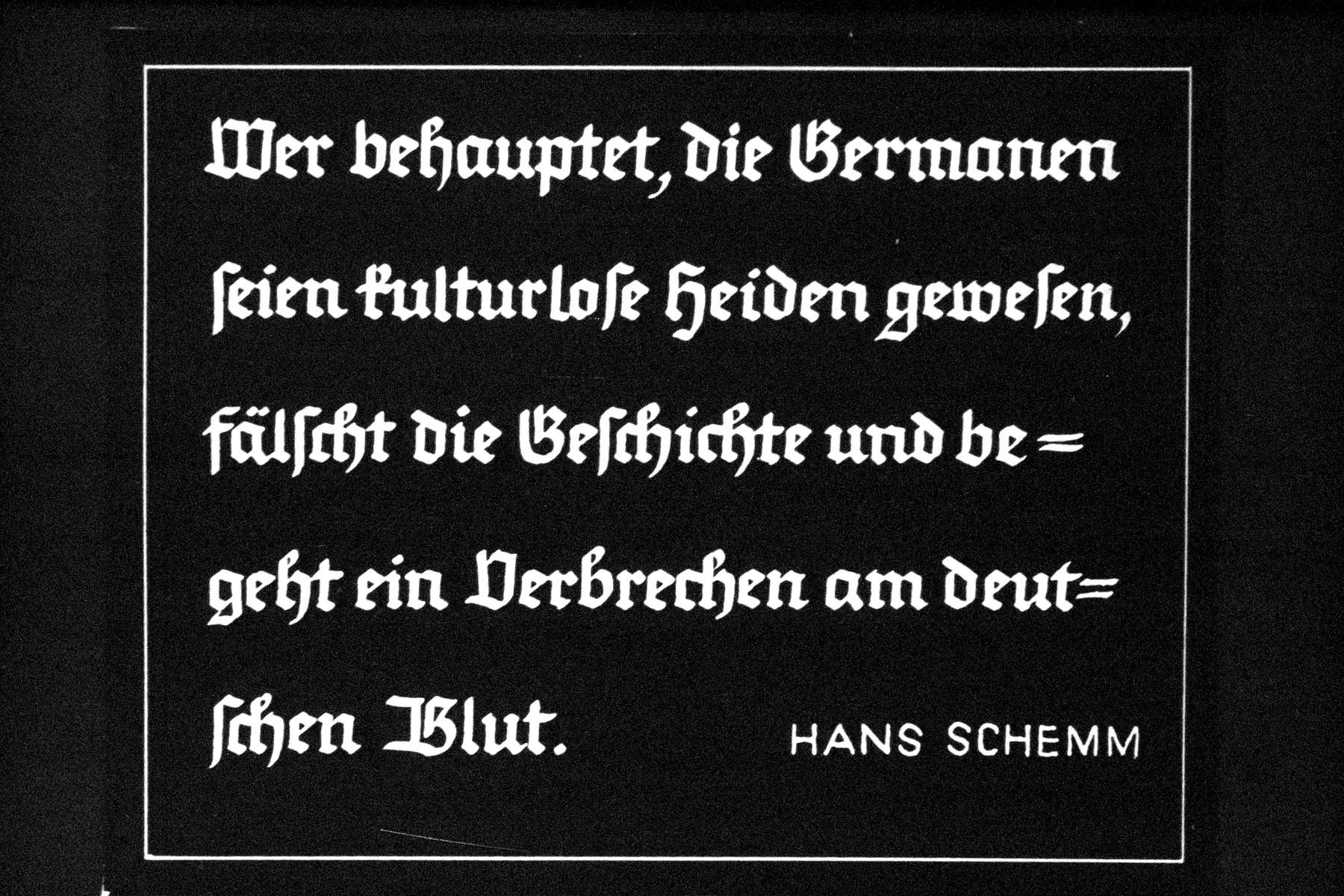 """38th Nazi propaganda slide for a Hitler Youth educational presentation entitled """"5000 years of German Culture.""""  Wer behauptet, die Germanen seien kulturlose Heiden gewesen, fälscht die Geschichte und begeht ein Verbrechen am deutschen Blut. HANS SCHEMM // Who claims that the Germans were uncultured heathens, falsifies the history and commits a crime against the German blood. HANS SCHEMM"""
