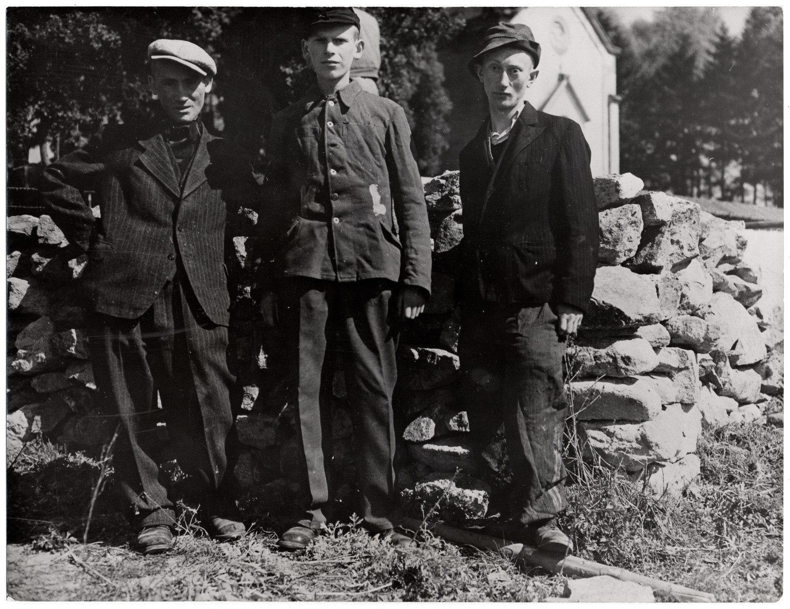 "Portrait of three survivors of the Schwartzenfeld atrocity,  Original Caption: ""These three Polish Jews escaped the fate of many of their comrades. They hid in a cellar of a nearby home during an American air attack on the area and remained there until the arrival of Third Army troops.  When the troops of the 26th Infantry Divion, Third U.S. Army, captured Schwarzenfeld, Germany, April 22, 1945, another story of Nazi murder and atrocity was revealed. The Americans discovered that many hundreds of helpless persons, including allied prisoners-of-war and Polish Jewish slave laborers, had been shot in cold blood by Nazi SS troops, and their bodies thrown into a mass grave. The execution took place one day before the American forces captured the town. Schwarzenfeld is 47 miles east of Nuremberg and 28 miles west of the Czechoslovakian border.""  The original Signal Corps caption reads, ""THIRD U.S. ARMY DISCOVERS NAZI ATROCITY.  When troops of the 26th Infantry Division, Third U.S. Army, captured Schwarzenfeld, Germany, April 22, 1945, another story of Nazi murder and atrocity was revealed.  The Americans discovered that many hundreds of helpless persons, including Allied prisoners-of-war and Polish Jewish slave laborers, had been shot in cold blood by Nazi SS troops, and their bodies thrown into a mass grave.  The executions took place on the day before the American forces captured the town.  After making official record of the circumstances, U.S. Military Government officers ordered local German civilians to exhume the bodies and provide coffins and a civilized burial for the victims.  Schwarzenfeld is 47 miles east of Nuremburg and 28 miles west of the Czechoslovakian border.  BIPPA                                                        EA 64393  THIS PHOTO SHOWS:  These three Polish Jews escaped the fate of many of their comrades.  They hid in a cellar of a nearby home during an American air attack on the area and remained there until the arrrival of Third Army troops.  U.S. Signal Corps Photo ETO-HQ-45-34027. SERVICED BY LONDON OWI TO LIST B CERTIFIED AS PASSED BY SCHAEF CENSOR"