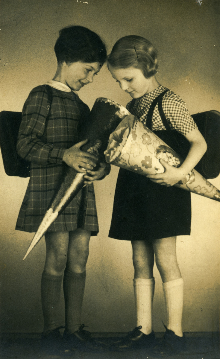Margot and Lotte Cassel pose with their cones and backpacks on their first day of school.