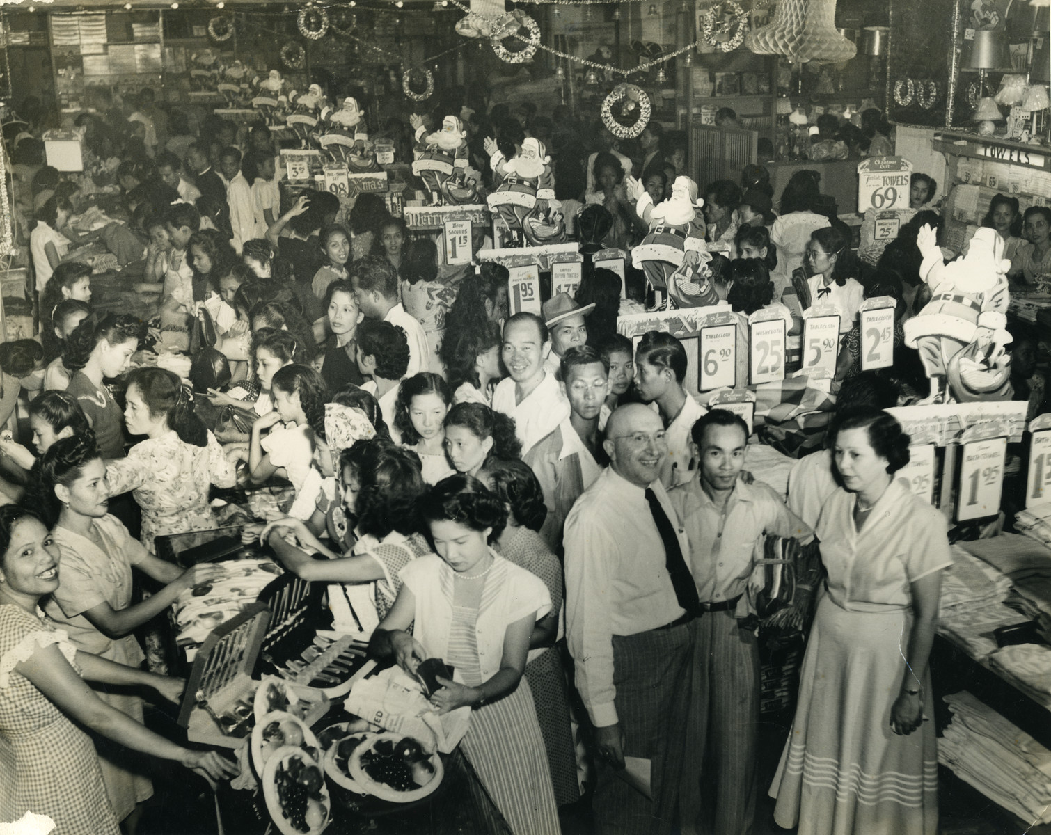 Saul and Erna Cassel (bottom right) work in the Berg department store.  Their assistant Pedro stands between then.
