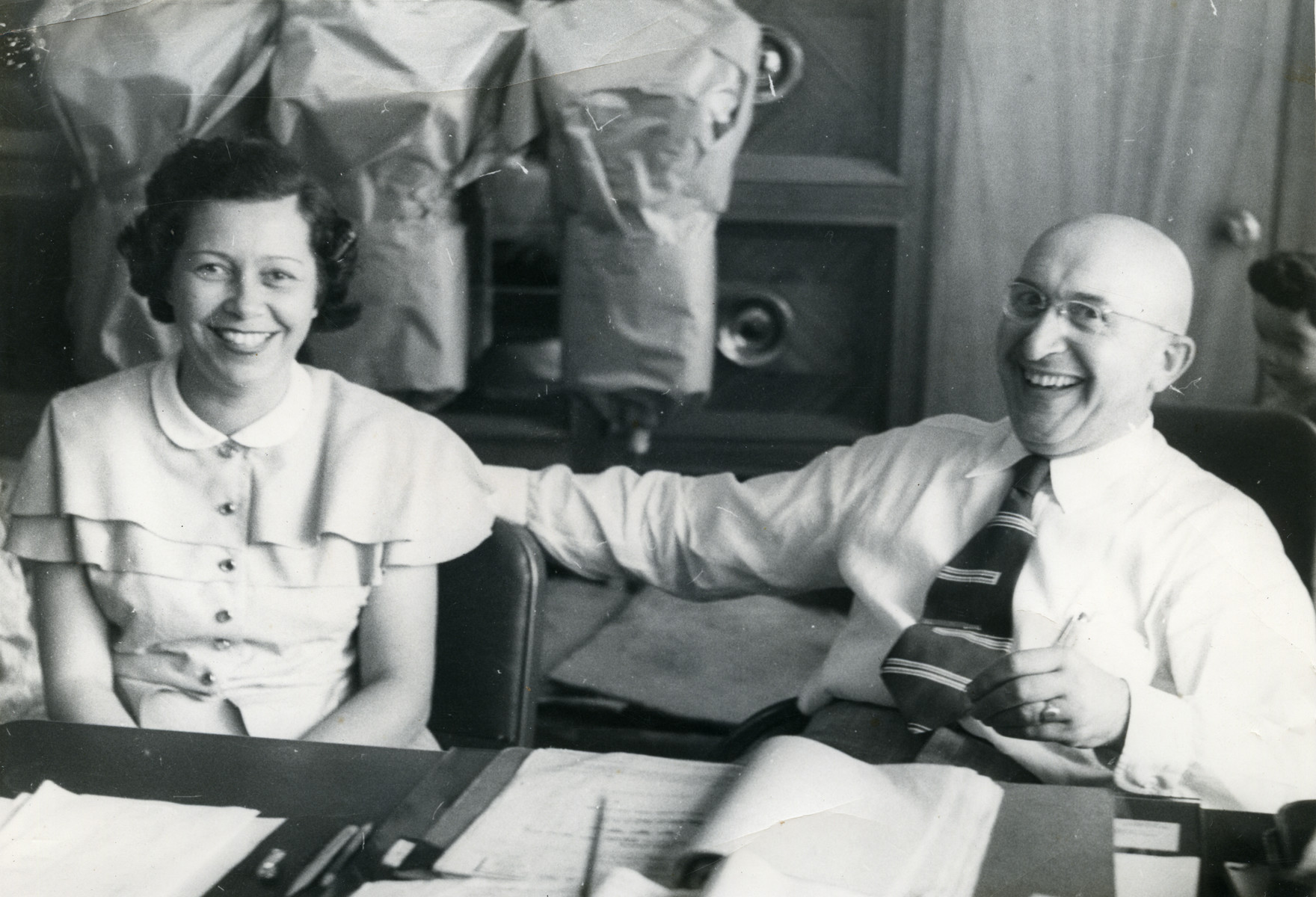 Erna and Saul Cassel sit together in their store.