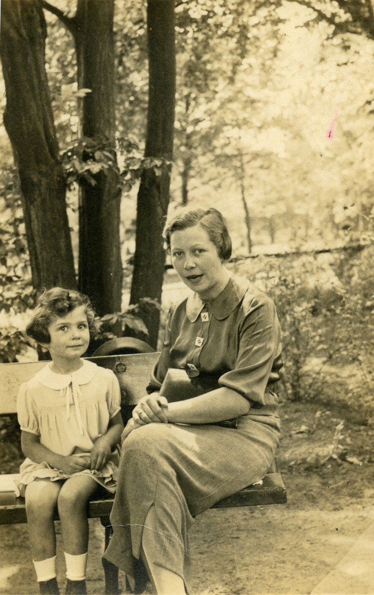 Margot Cassel sits next to her mother Erna on a park bench in Breslau, following her mother's return from a sanatorium.