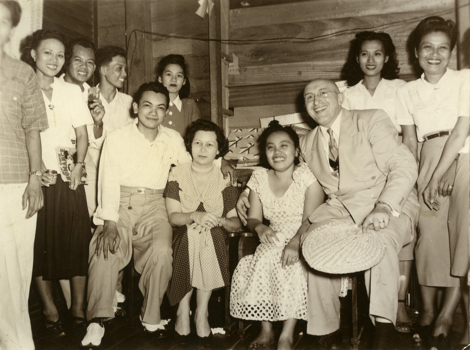 Saul and Erna Cassel pose with the staff of Berg's department store.