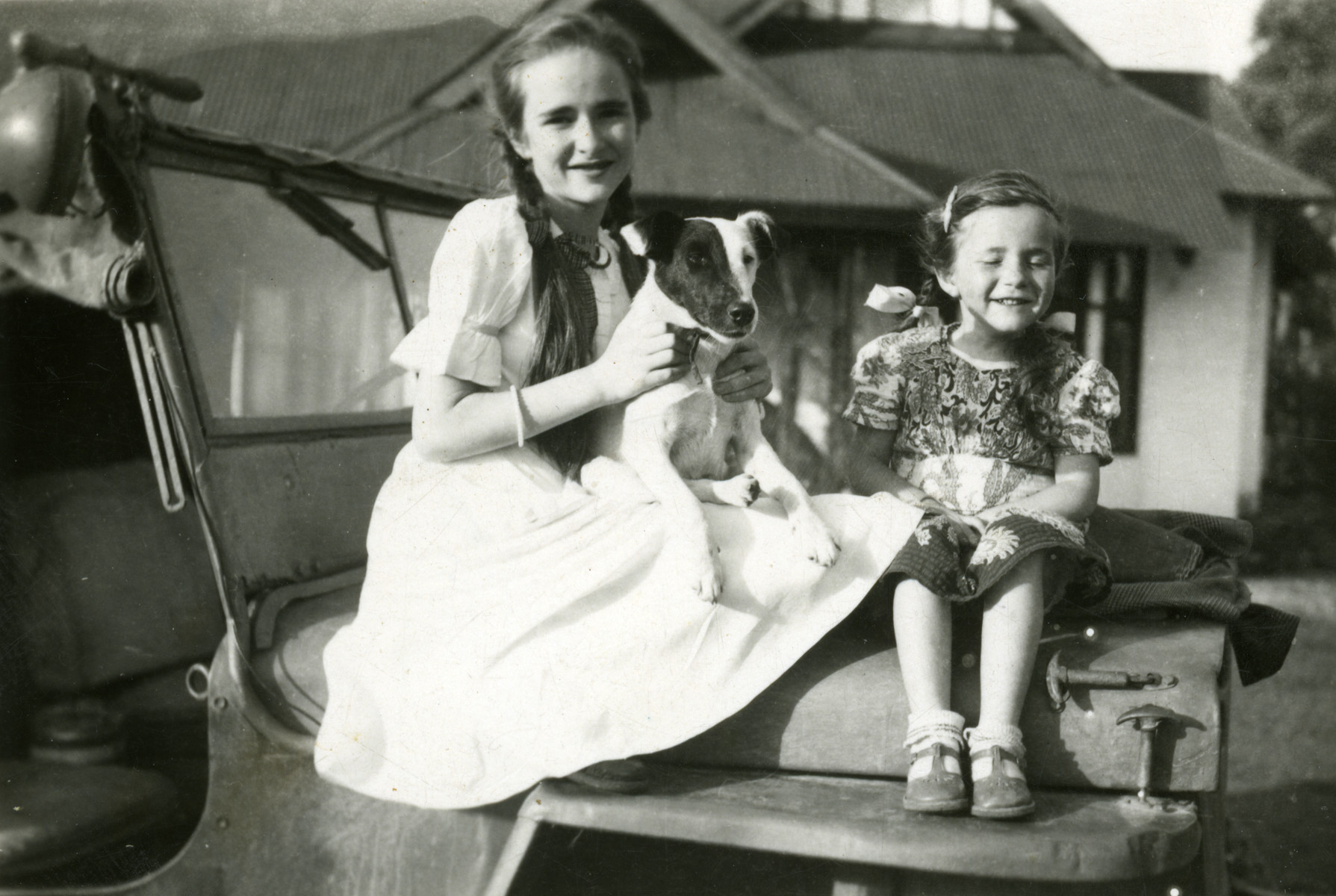 Felicity and Zahava Traub (cousins of the donor) sit on top of their father's Jeep which he bought from a US Army surplus store.