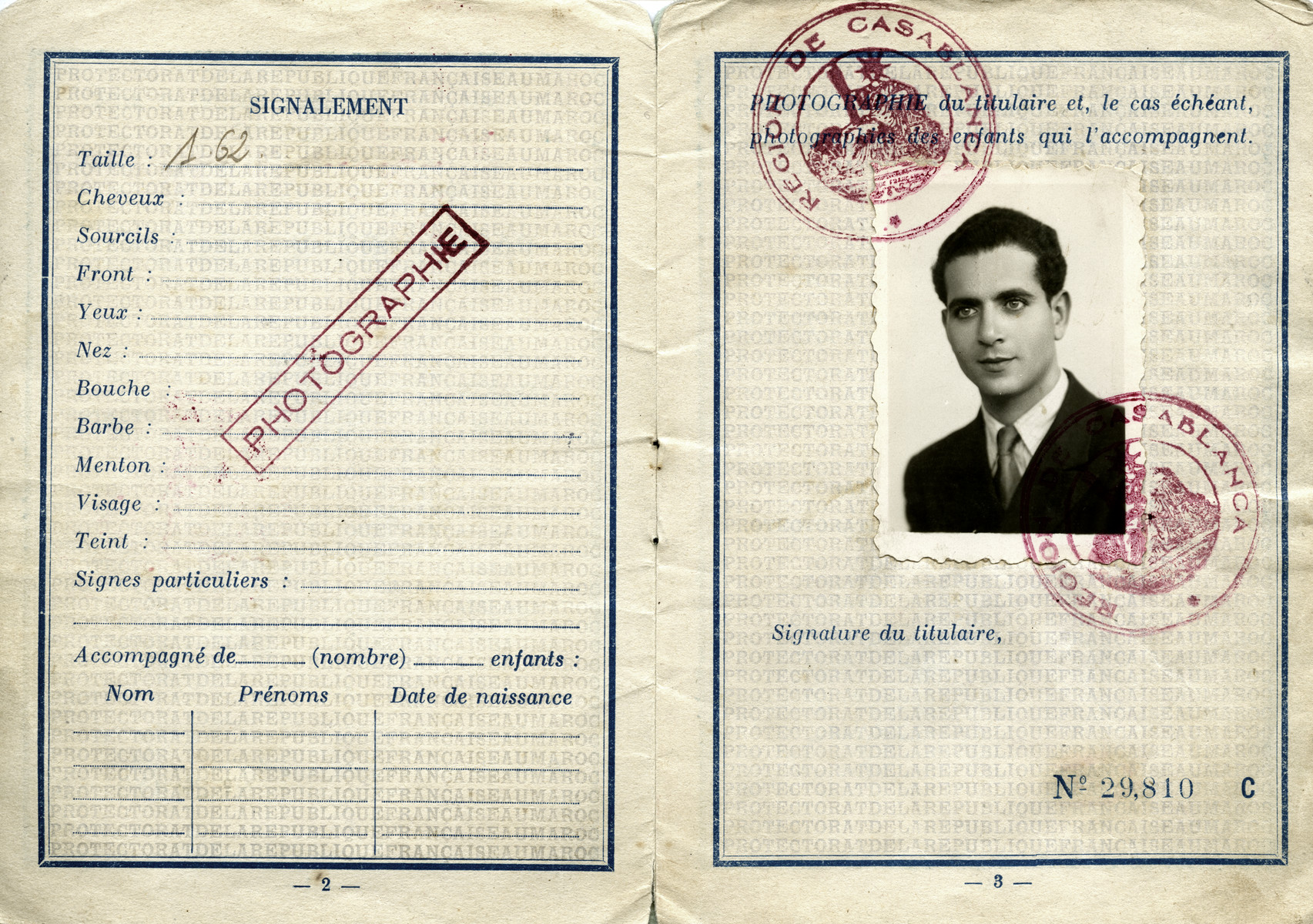 Pages from Shimon Sousson's Moroccan passport with his photograph.