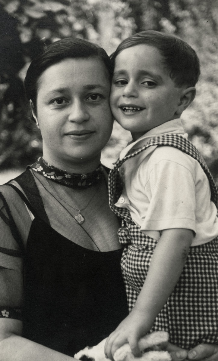 Esther Weeg poses holding her young son William.