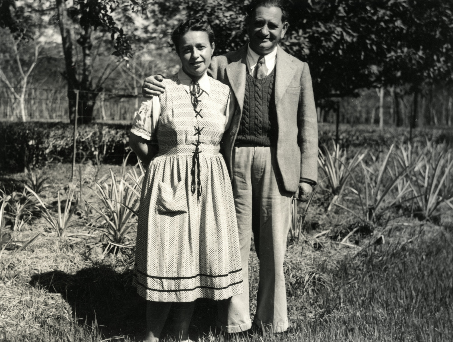 Maurice and Esther Weeg pose together in a garden in India.