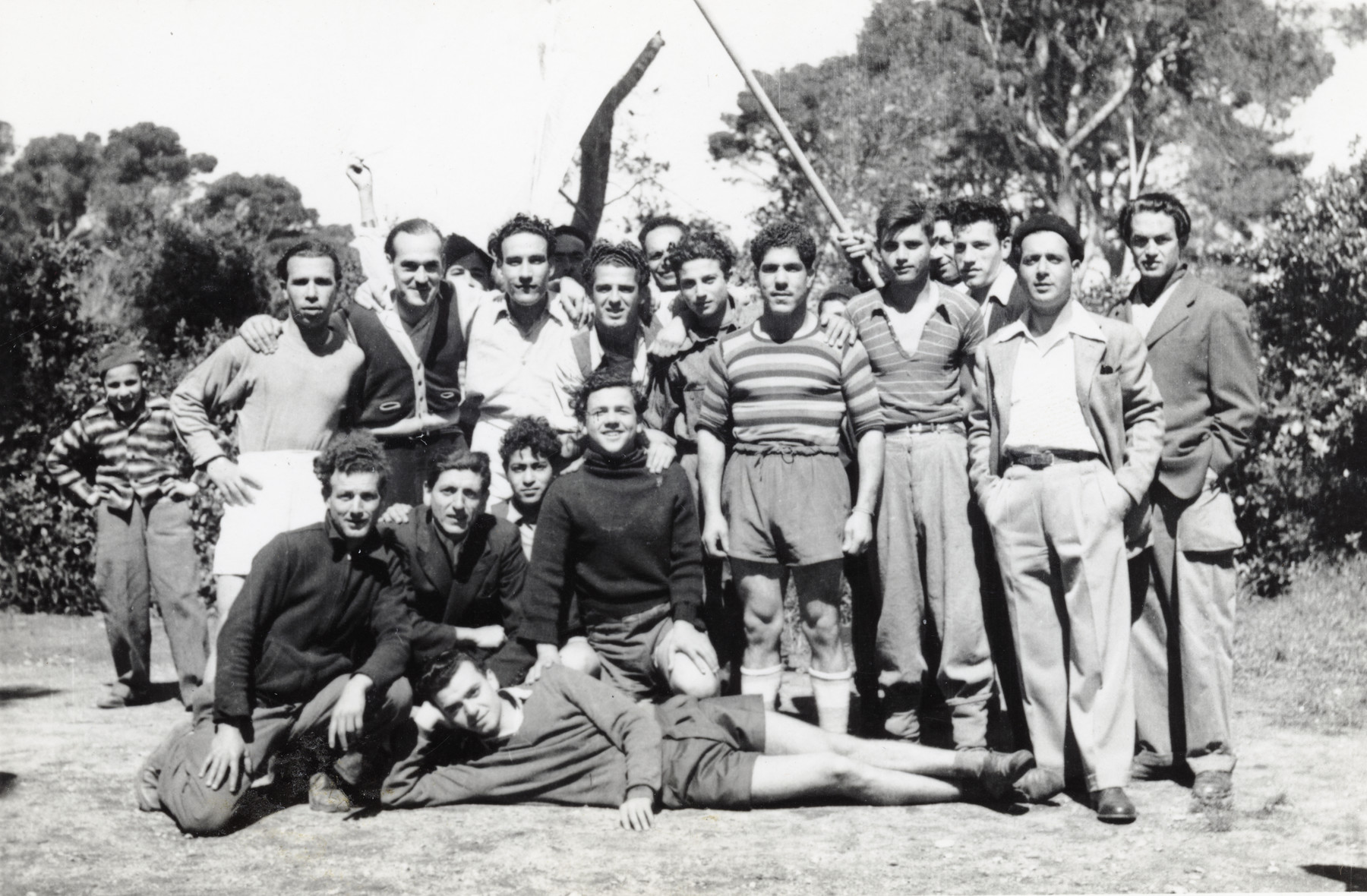 Immigrants from North Africa in Mahane David, an immigration camp for North African Jews en route to Israel.   Shimon Sousson is in the first row (second from the right) with his hands in his pockets.