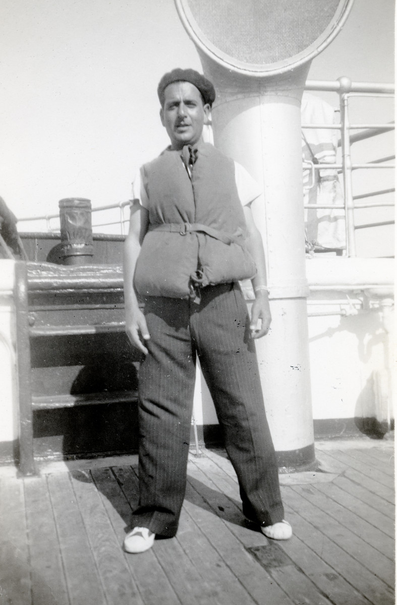 Shimon Sousson poses in a lifejacket on the ship Negba en route to Israel.