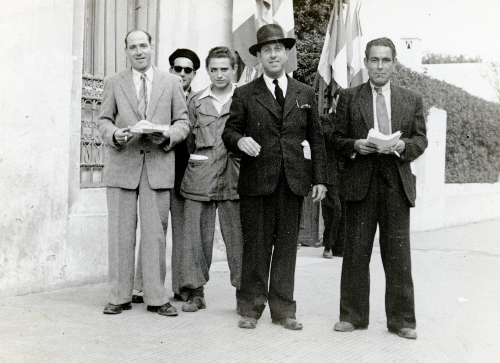 Shimon Sousson (second from the right) poses with four  other men on election day in postwar Morocco.