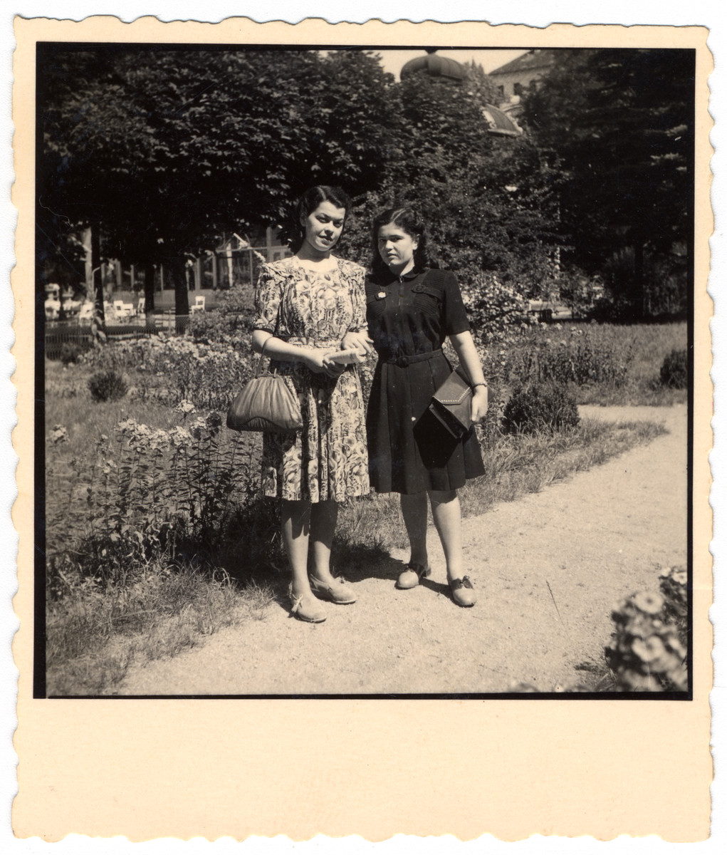 Ruth and Teresa Friedman, sisters who survived Auschwitz together, stand by a garden in Zatec after the war.
