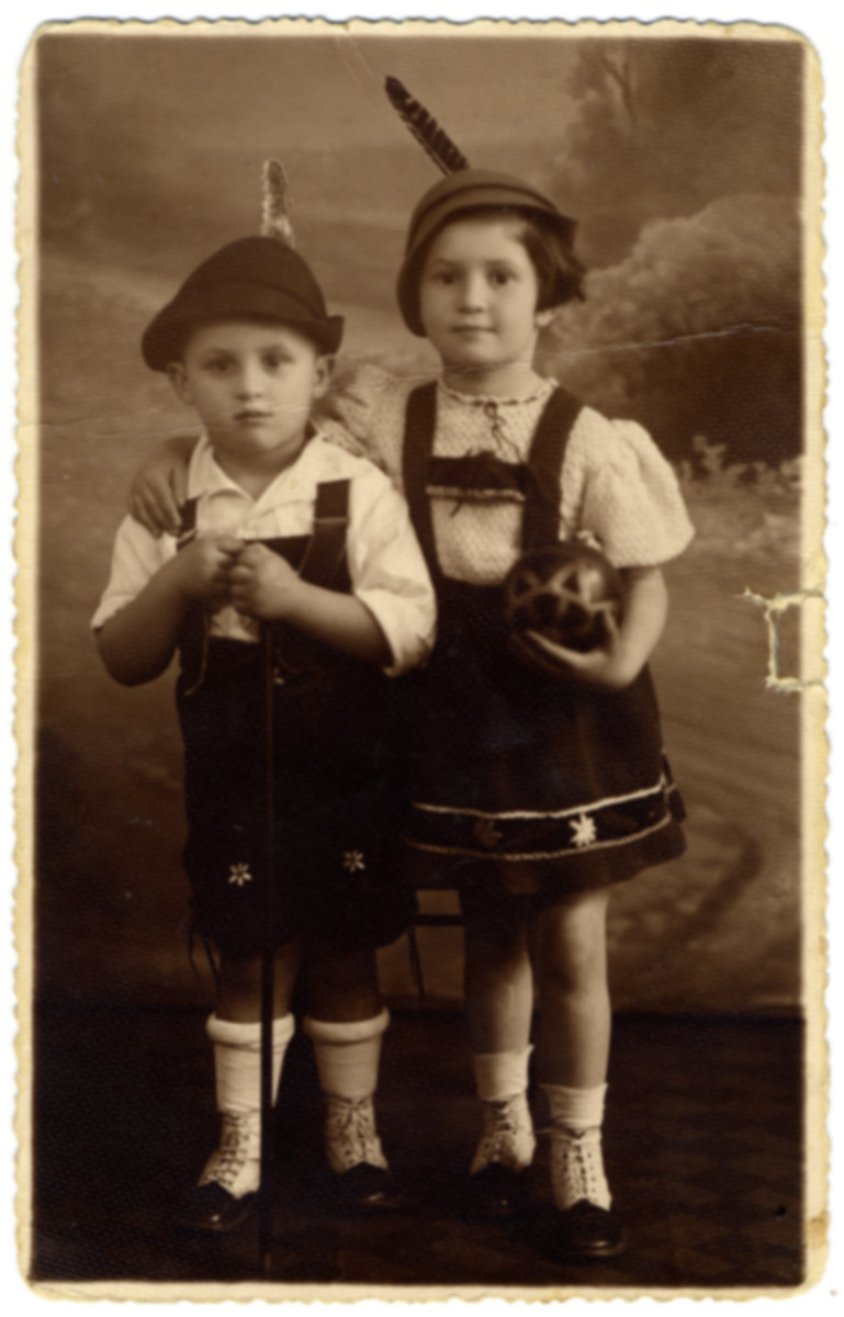 Studio portrait of Aaron and Ruth Friedman wearing Alpine garb crocheted by their mother.