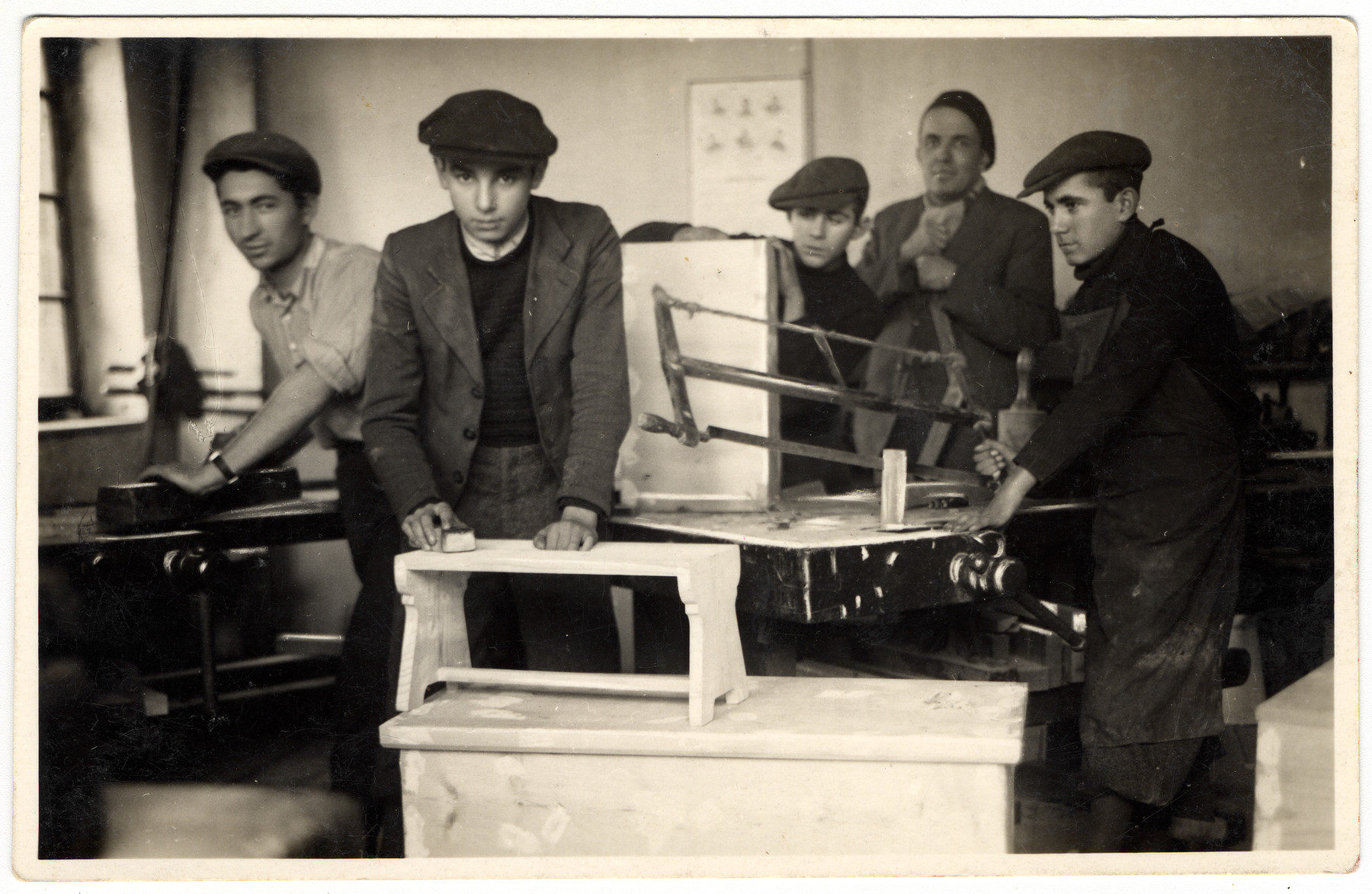 Young religious men work at carpentry shop at a combination yeshiva and vocational training school (hachsharah) in Hlohovec run by Rabbi Moritz Schwartz.  All the boys immigrated to Palestine.