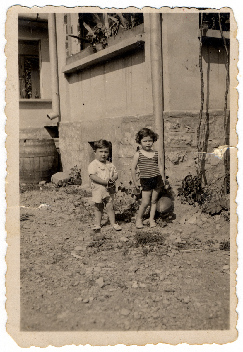 Ruth and Aharon Friedman play outside their home in prewar Mukachevo.