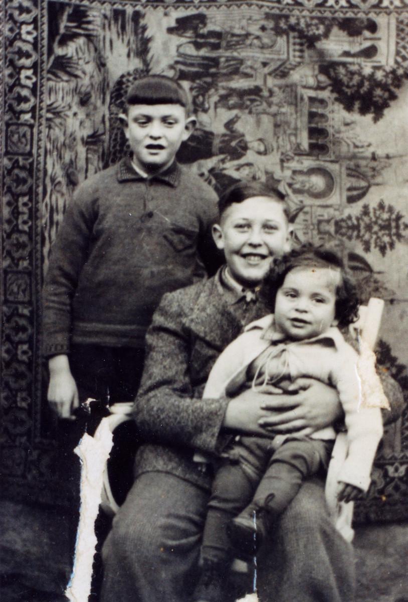 Studio portrait of three German-Jewish brothers.  Pictured are Kurt, Heinz and Berthold Guth.