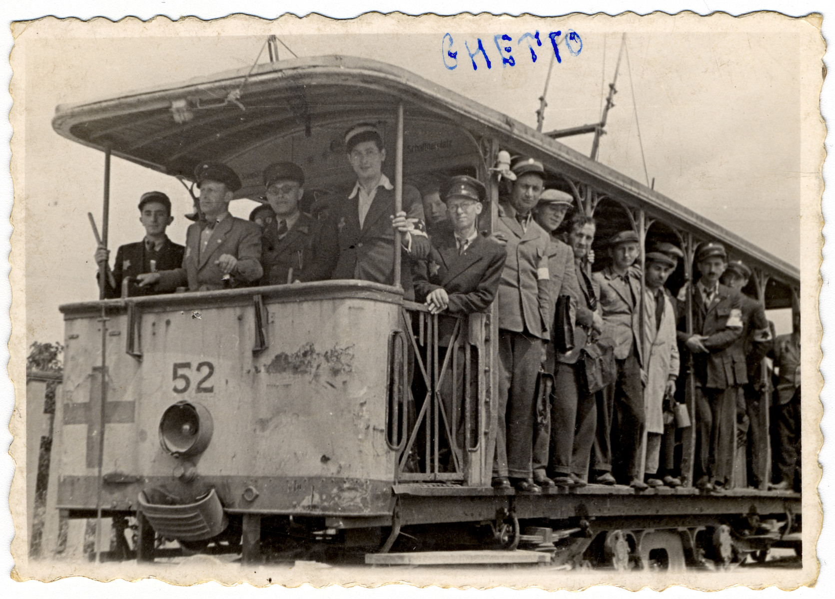 Group portrait of Jewish policemen posing on a streetcar of the Lodz ghetto.  The driver of the streetcar is Rozenbaum.