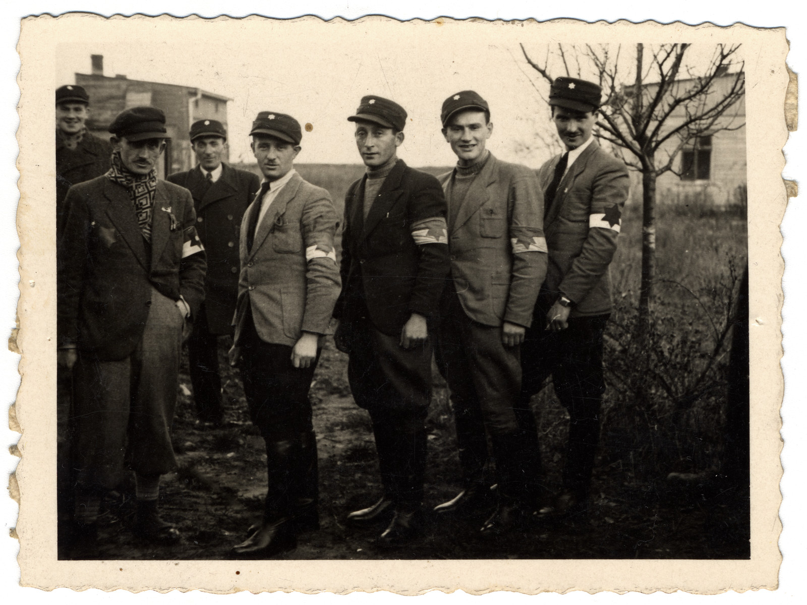Jewish policemen from the Lodz ghetto pose for a group portrait.
