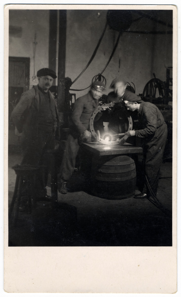 Young men work work at a foundry at a combination yeshiva and vocational training school (hachshara) in Hlohovec run by Rabbi Moritz Schwartz.  All the boys later immigrated to Palestine.