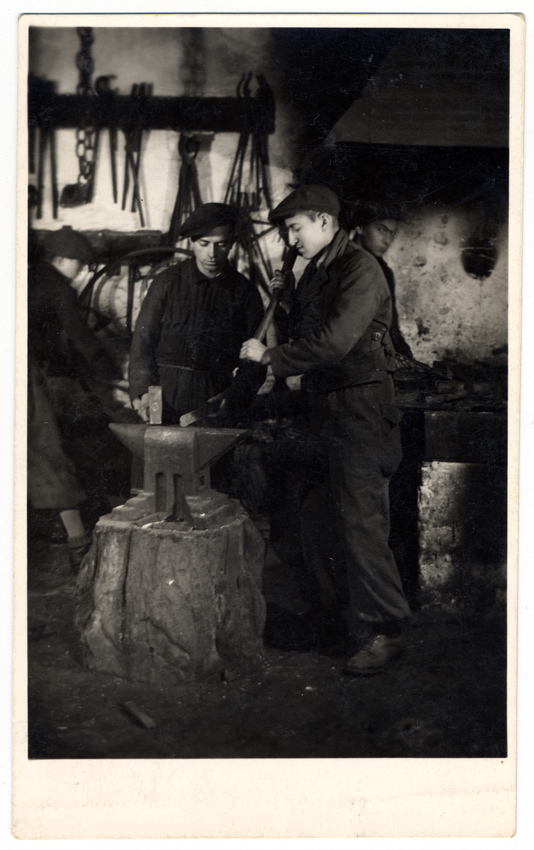 Two young men work at blacksmith shop at a combination yeshiva and vocational training school (hachsharah) in Hlohovec run by Rabbi Moritz Schwartz.  All the boys immigrated to Palestine.