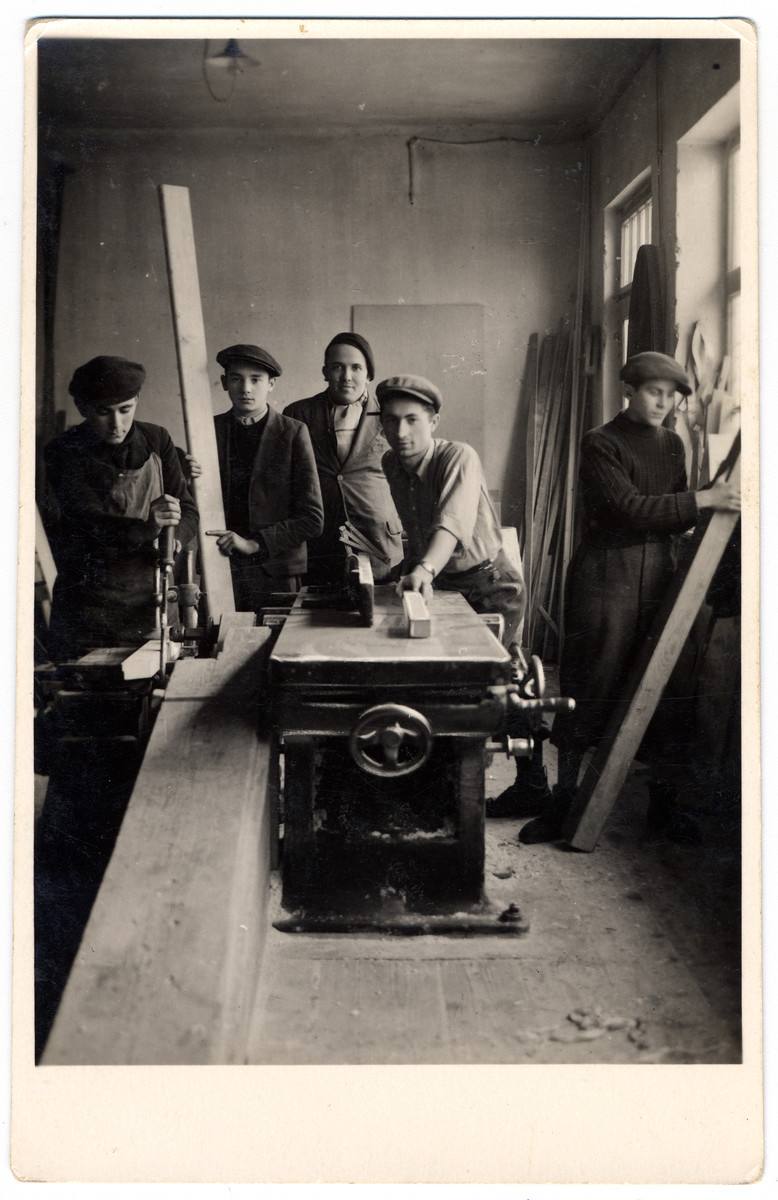 Young men work work in a carpentry shop at a combination yeshiva and vocational training school (hachsharah) in Hlohovec run by Rabbi Moritz Schwartz.  All the boys immigrated to Palestine.