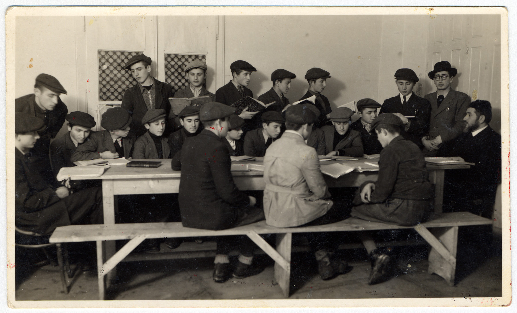 Young men work study religious texts at a combination yeshiva and vocational training school (hachsharah) in Hlohovec run by Rabbi Moritz Schwartz.  Eli Schwartz (the cousin of the donor) is on the far right wearing a hat.  All the boys later immigrated to Palestine.