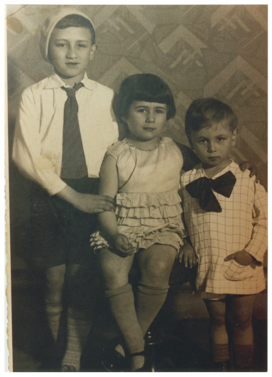 Studio portrait of the Keller children, three Jewish siblings in Antwerp.    They were cousins of the donor and were deported first to Malines and then to Auschwitz where they perished.
