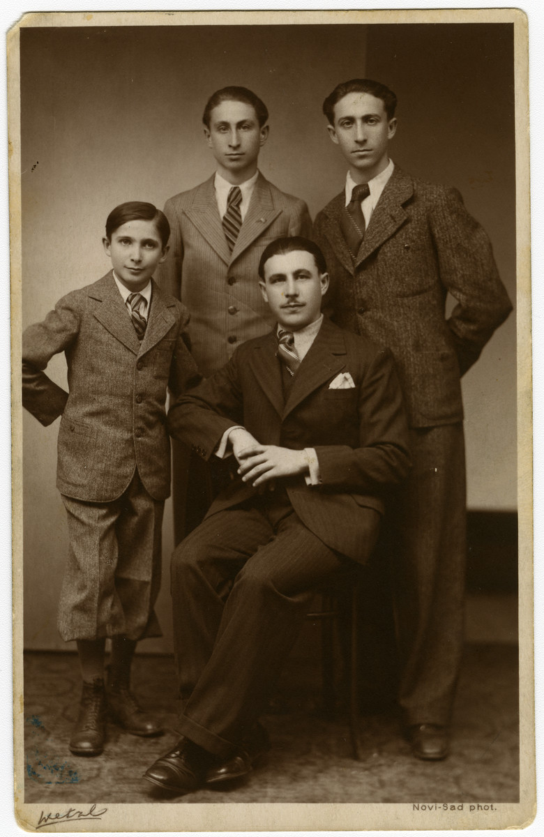 Studio portrait of the four Ripp brothers.  Pictured are Daniel, Imre, Theodore and Michael Ripp.