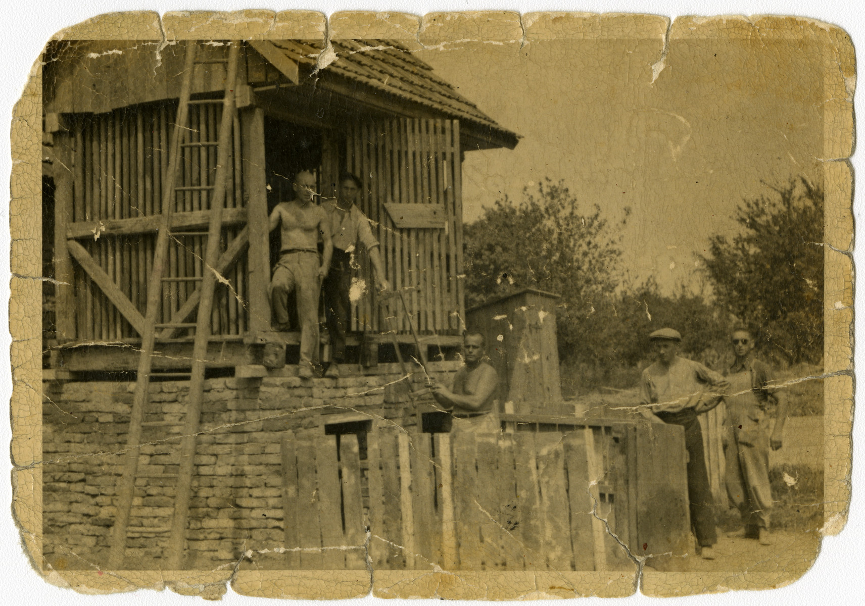 Serbian Jews are forced to work on a construction project.  Daniel Ripp is pictured in the structure on the right.