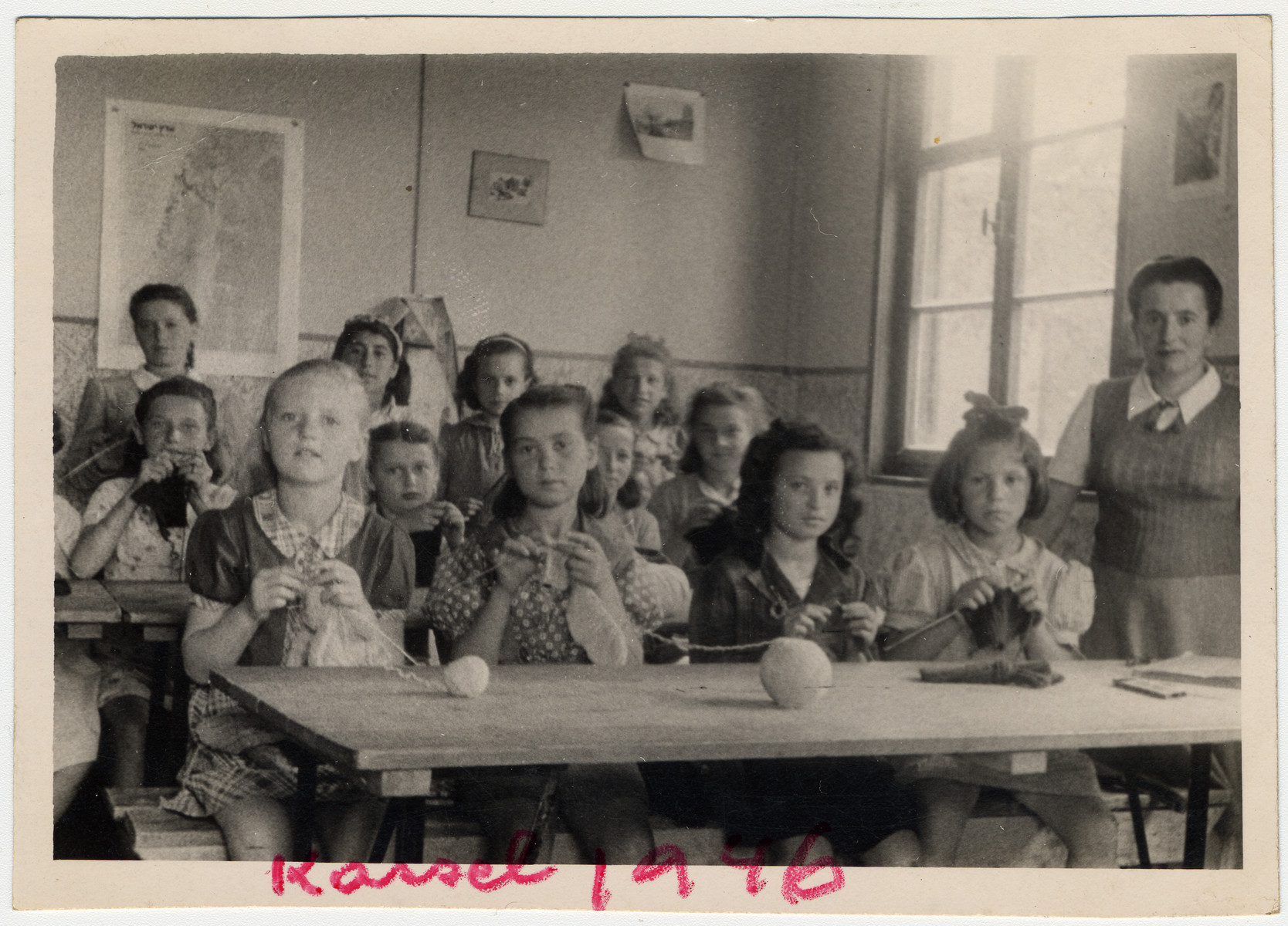 Rose Goldfarb (the donor's mother) teaches a knitting class in the Kassel displaced persons camp.