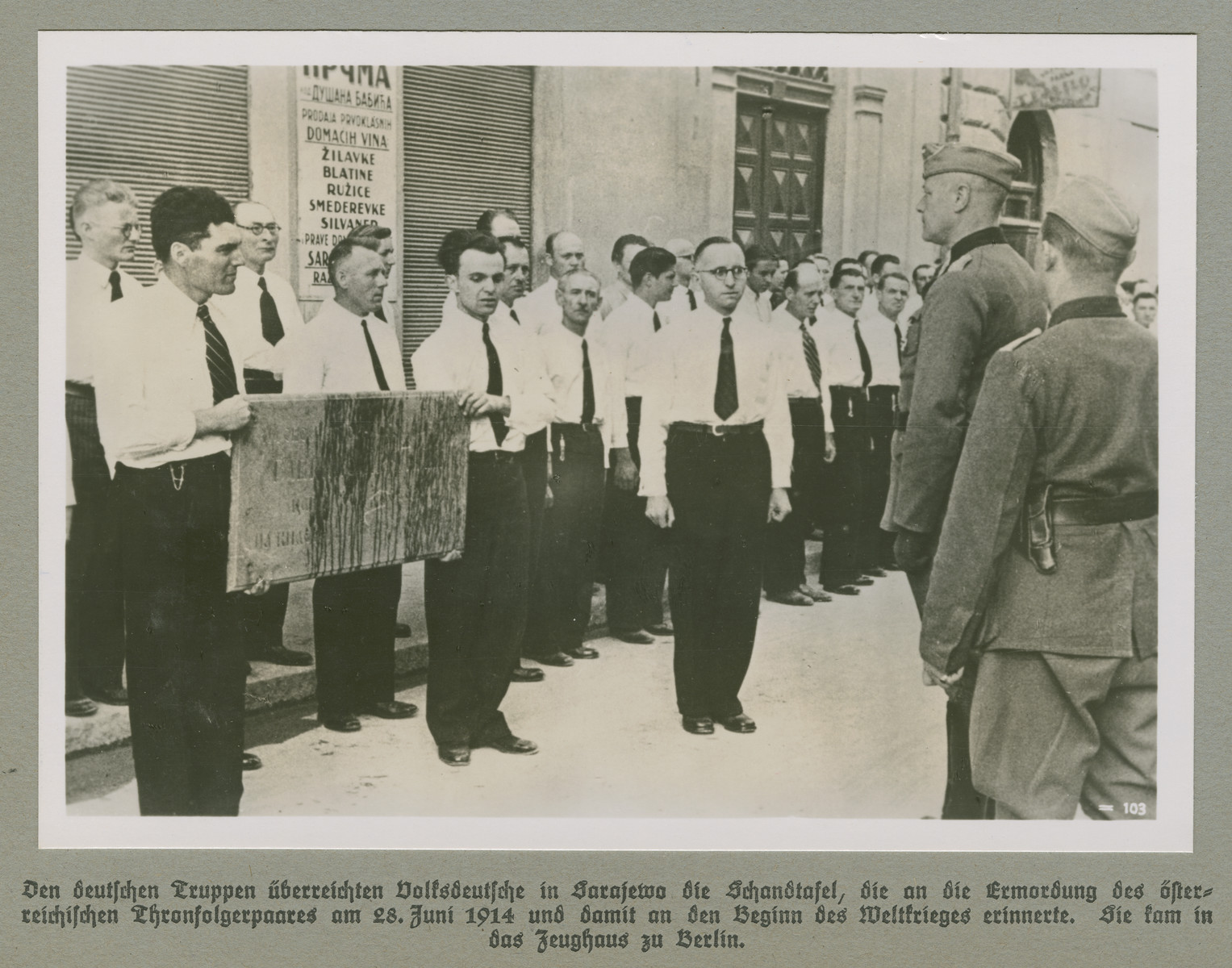 Ethnic Germans greet German forces in Sarajevo.   The original caption reads: German forces were presented the infamous slab commemorating the murder of the Crown Prince and Princess of Austria on June 28, 1914, which led to the beginning of the First World War.  The slab was conferred to the Zeughaus in Berlin.