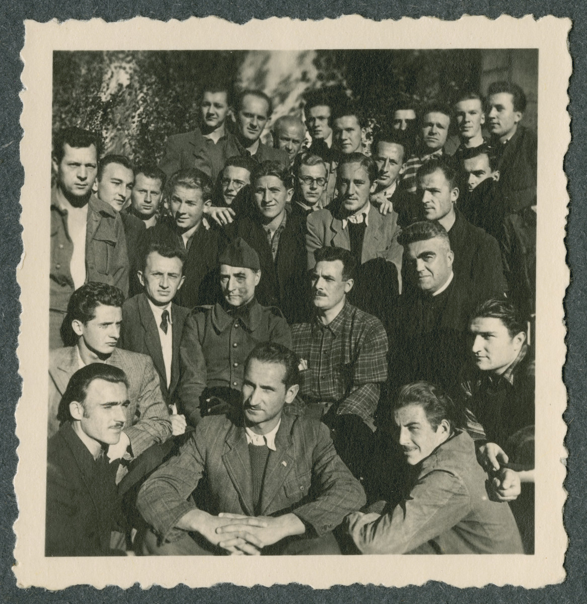 Group portrait of prisoners in the Tittmoning camp.    Father Sledz is on the right, second row.