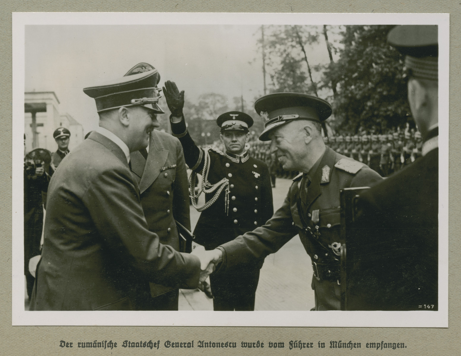 Adolf Hitler shakes hands with Prime Minister of Romania Ion Antonescu.    The original caption reads: The Romanian head of state Antonescu was welcomed by the Führer in Munich.