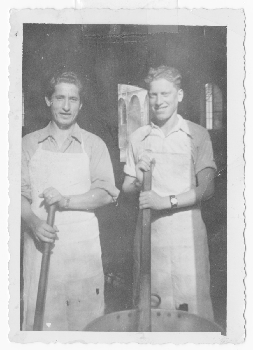 Bernard Pasternak (left) and another man work in a kitchen [possibly in the Bagnoli or Trani displaced persons camp.]