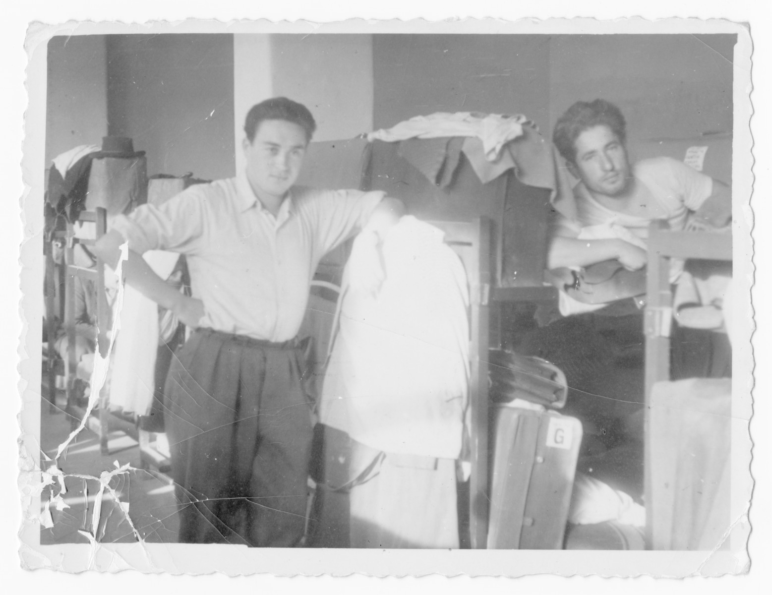 Bernard Pasternak (right) and another man pose in the barrack of an unidentified displaced persons camp.