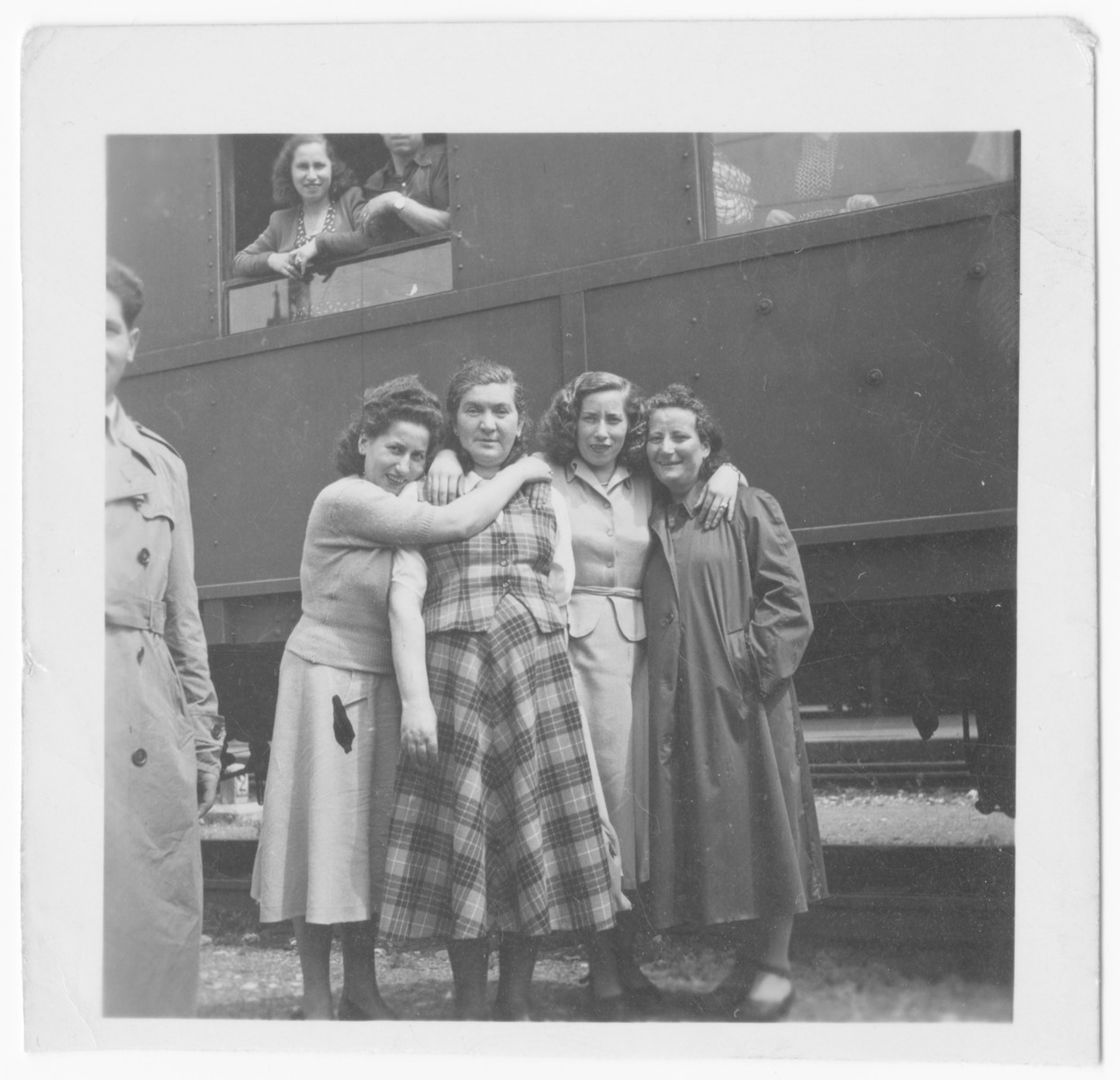 A group of young female displaced persons gather at the Salzburg train station to say goodbye to some friends.  Bella Simon is probably pictured on the left.