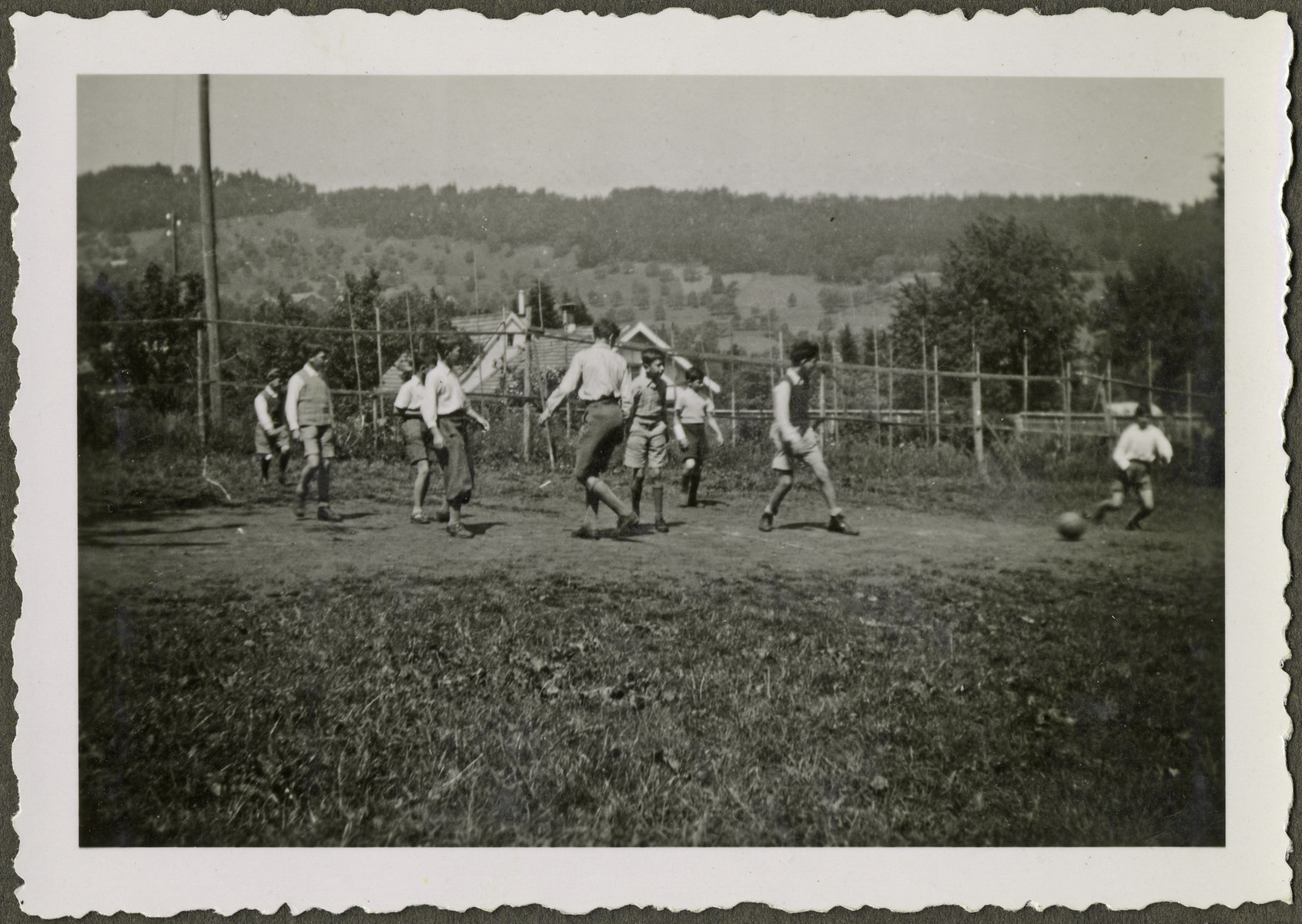 Children play soccer in a home in Heiden, Switzerland.  Manny Mandel is pictured third from the left.  The photograph was posed for the Red Cross.