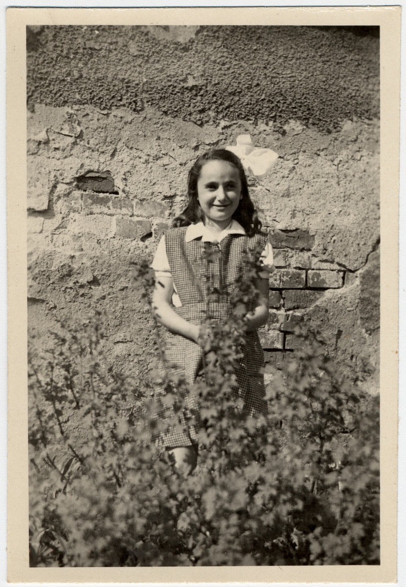 Katie Engel stands next to a wall in a garden in Zabokreky, Slovakia