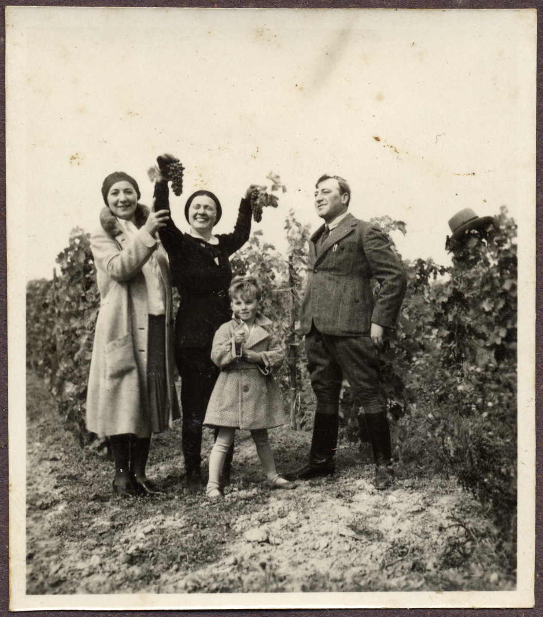 Greta Engel shows off their grape harvest on a farm, in Mileberg Castle, Austria.    On the right is her brother Paul Stoessler.  On the right is another sister.