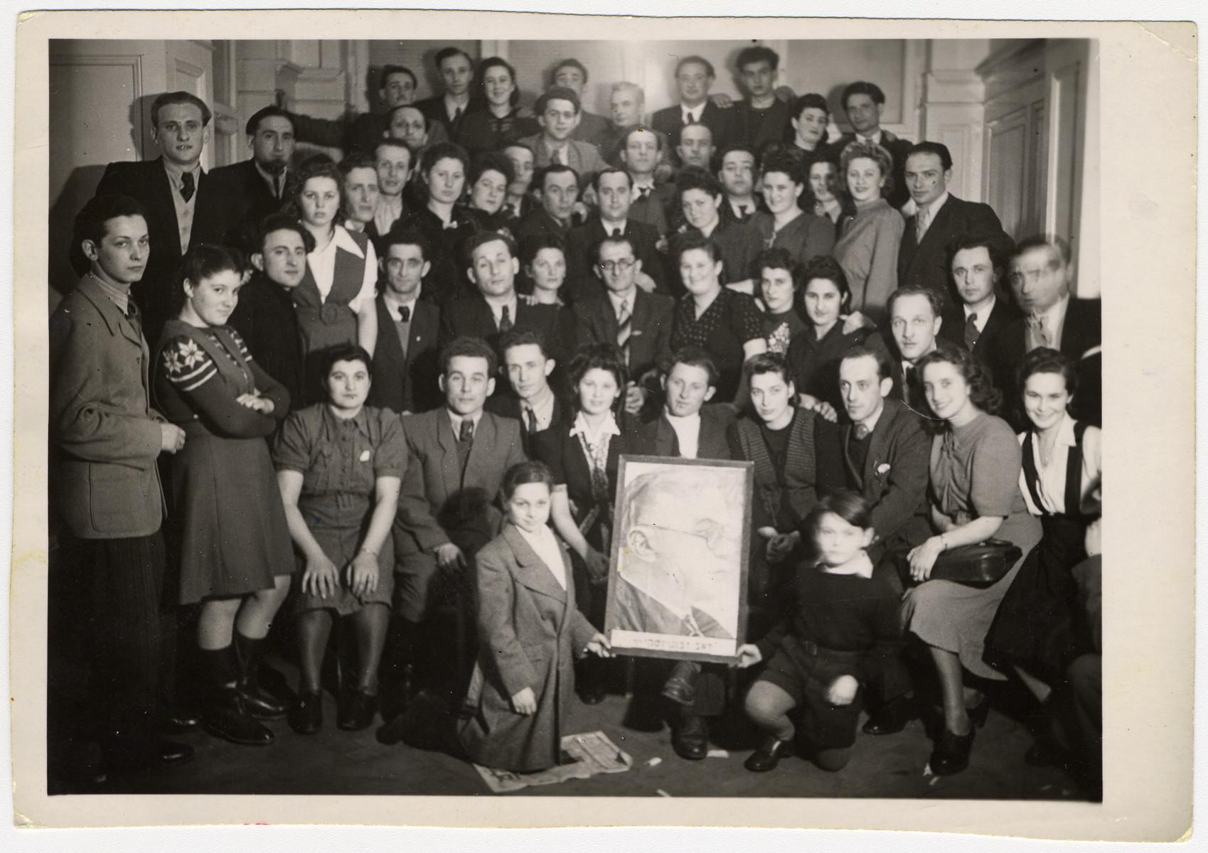 Members of Betar pose with a portrait of Zeev Jabotinsky in Heidelberg.