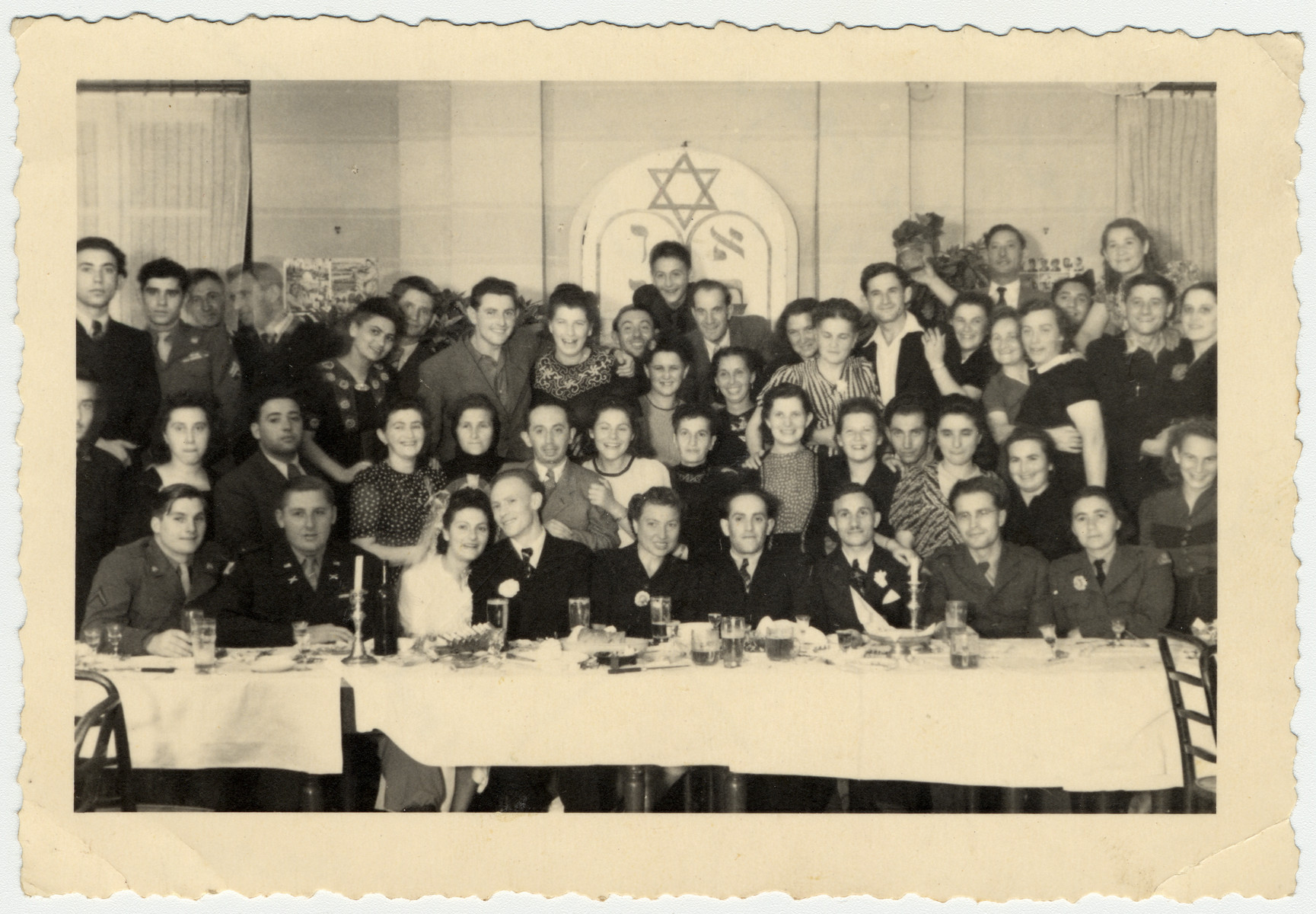 A large group of displaced persons and American soldiers celebrate a wedding in Lindenfels.