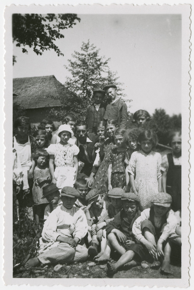 Group portrait of Jewish children in Kusnice.  Ruth Weinberger is pictured in the middle beneath the two boys.