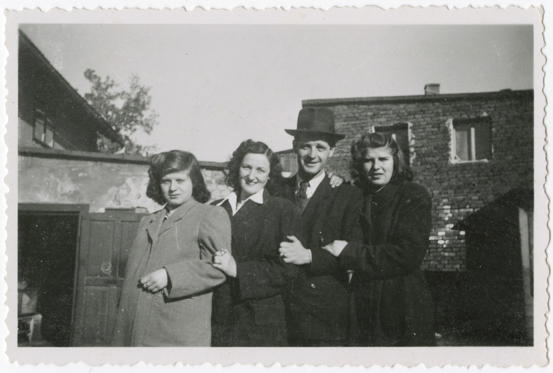 Four cousins pose togther in Kusnice prior to the German invasion.  From left to right are Helena, Esti, Bernard and Ruth.  Helena and Ruth were the sisters of Eva Weinberger.  Bernard was their cousin, and Esti was Bernard's future wife.  All four survived the Holocaust.  Bernard and Esti later immigrated to Bolivia.
