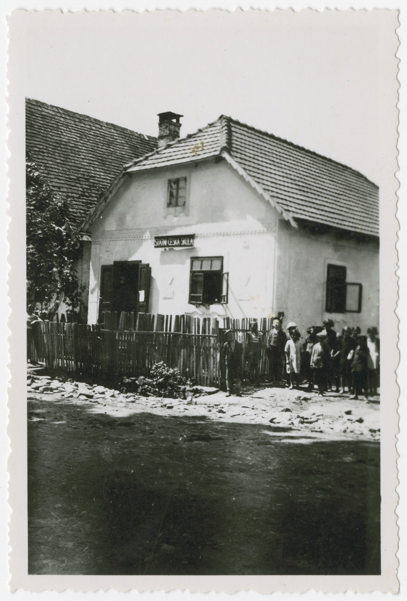 Young children stand outside the Jewish school in Kusnice.