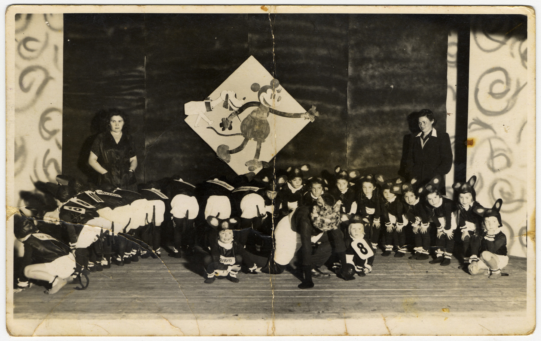 Children dressed as mice put on a school performance at the Novaky labor camp.  Among those pictured is the donor Mira Menzer (second row, sixth from the right).