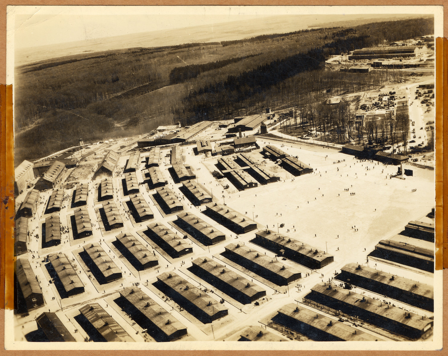 """Postwar aerial view of Buchenwald concentration camps, showing the barracks.  The lender's handwritten caption reads, """"Air photo of concentration camp Buchenwald.   1.  Right-extreme and center monument to 51,000 persons who died there. 2.  Center with smoke stack torture chamber and mortuary."""""""
