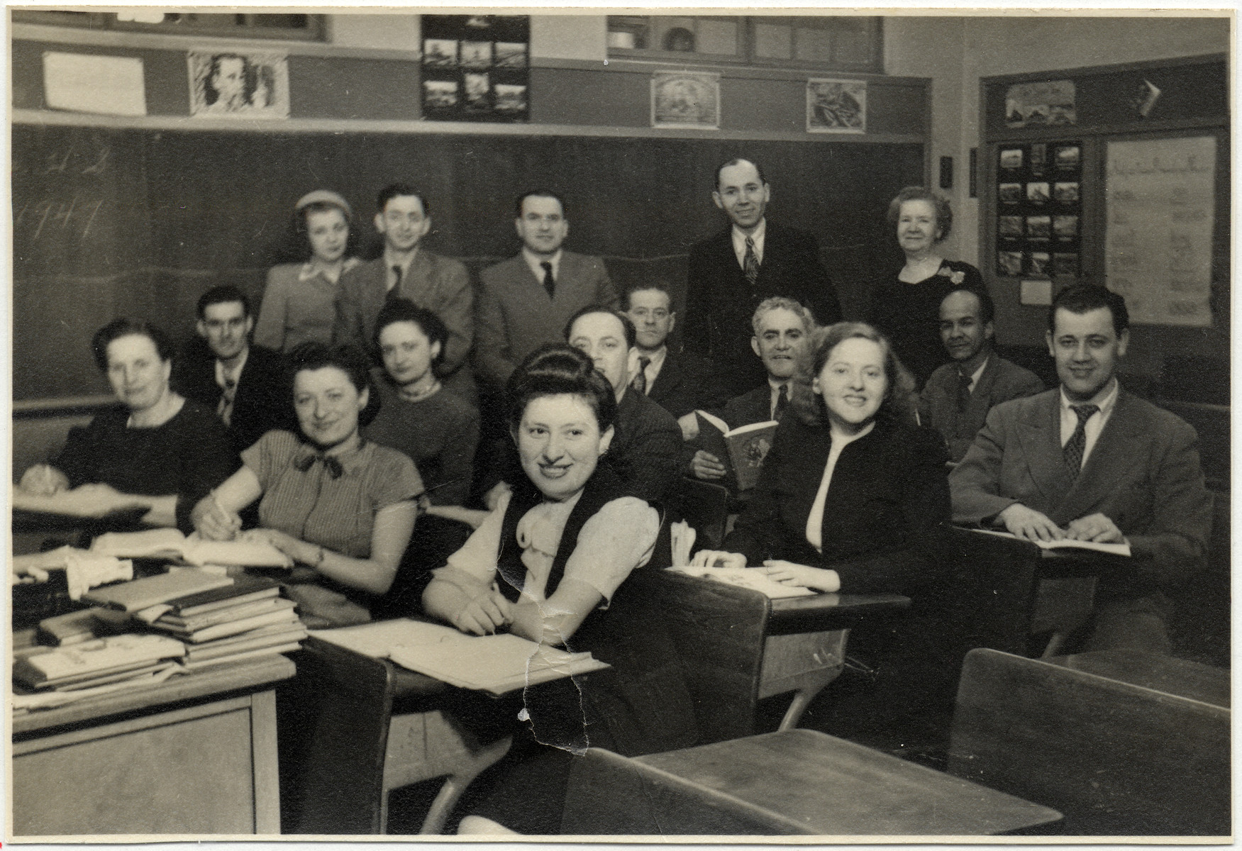 Group portrait of students in an English language class for Deaf immigrants, taught by Alice McVan, a Gallaudet alumna.  Among those pictured are Hilda Wiener Rattner (far left) and  Richard Wiener (back row, third from left).