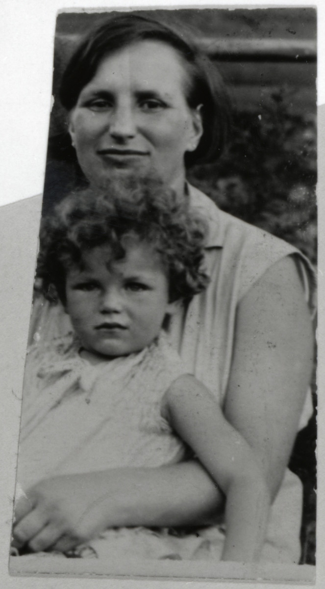 Hilda Wiener Rattner holds her daughter, Lilly, on her lap.
