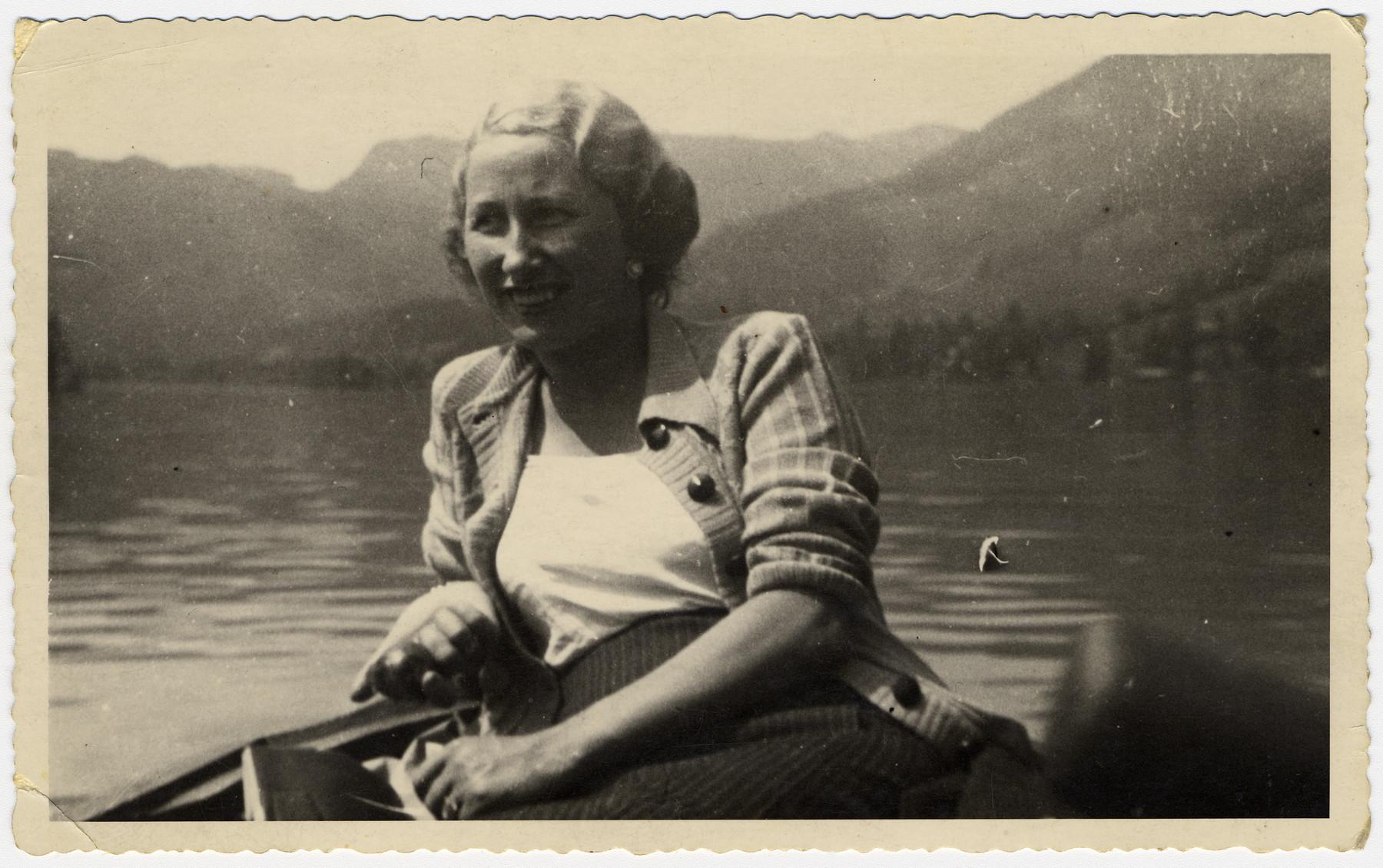 Martha Holzmann takes a boat ride near the Austrian Alps.