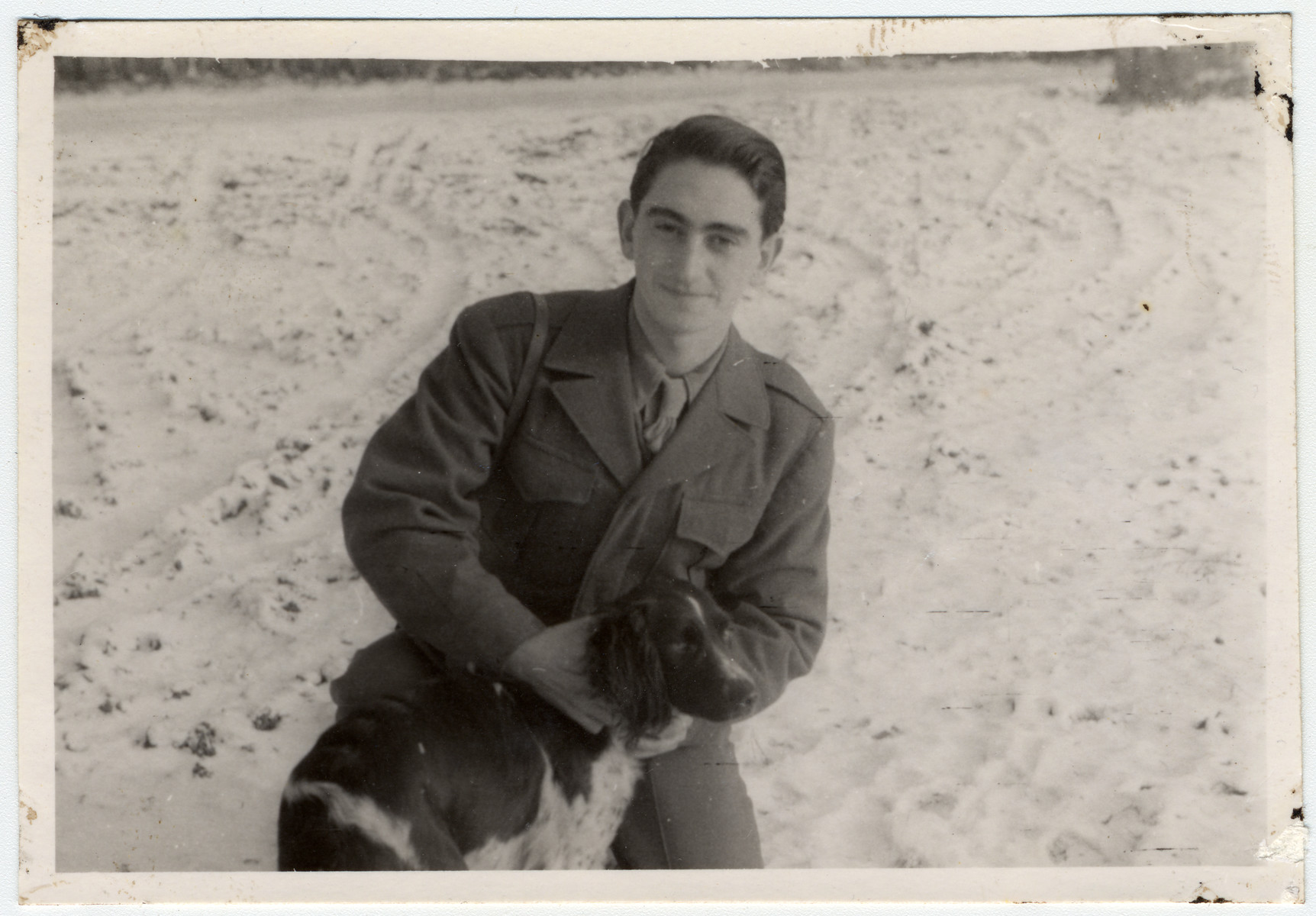 Shmuel Shalkovsky (donor), a Lithuanian survivor, poses with a dog in Germany where he is helping the American army of occupation.